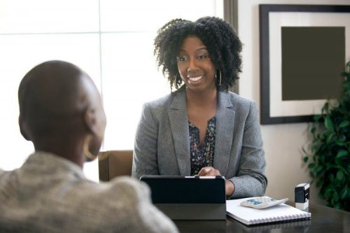 A tax professional discusses options with a client.