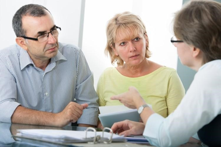 A tax lawyer meets with clients.