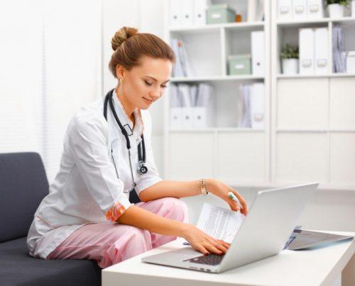 A nurse studies online.