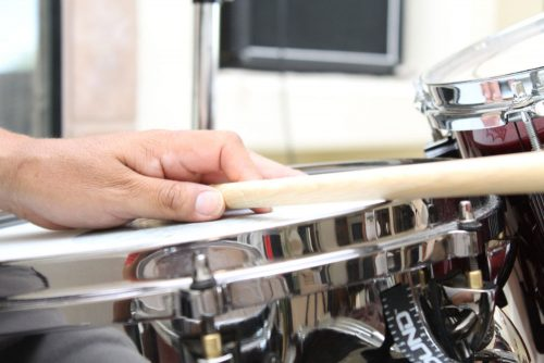 Percussionist's hand rested on drum.