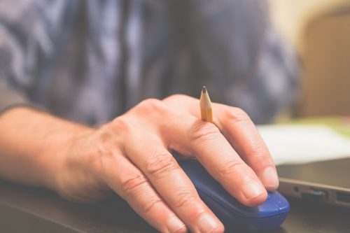 Man using computer mouse.