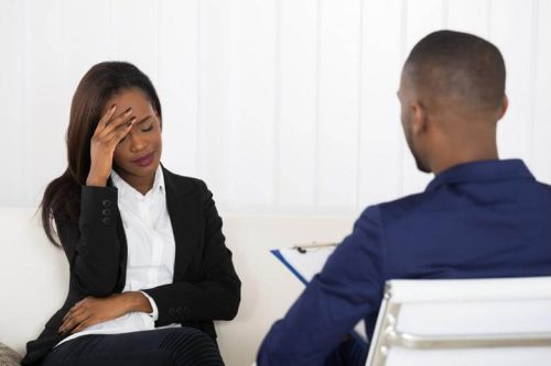 Distressed client talking to counselor.