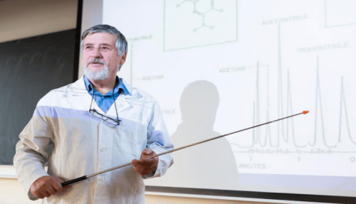 A chemistry professor presents a lecture