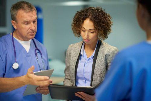 Medical professionals consulting data.