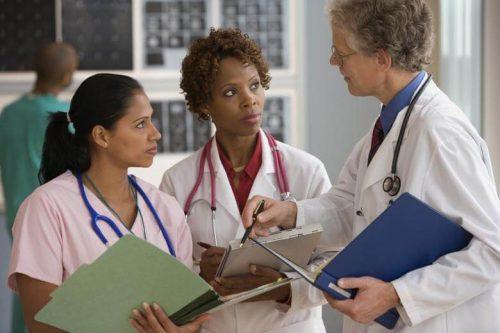 Group of nurses talking together.