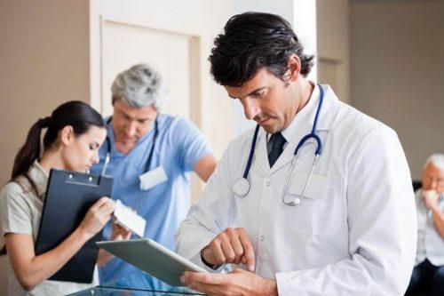 Nurse practitioner working on tablet.