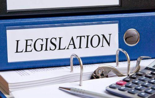 A binder labeled 'legislation'