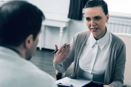 A substance abuse counselor speaks with a client.