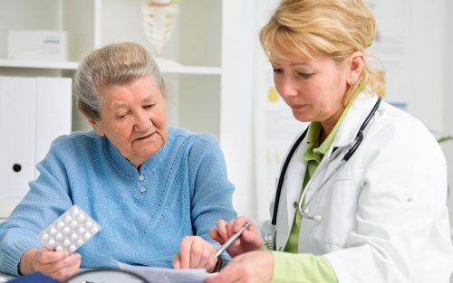 Nurse Practitioner with older woman patient