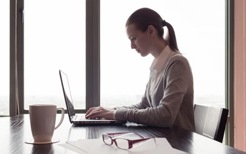 Female medical professional working on laptop