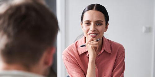 Young woman counsels man