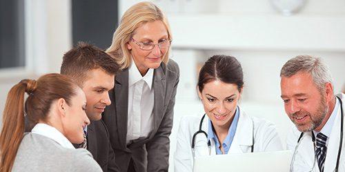 Nurse administrator talks to a group of doctors