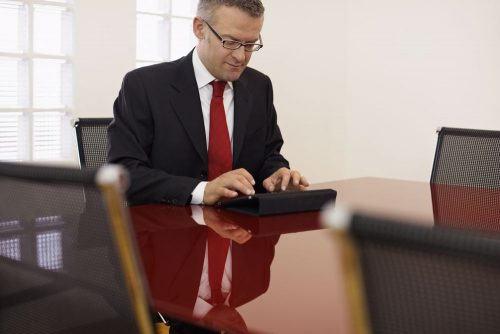 A chief academic officer works on a tablet