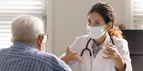 Young female doctor consults with elderly male patient
