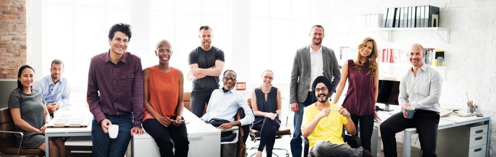 Employees of a culturally diverse company gather in an office