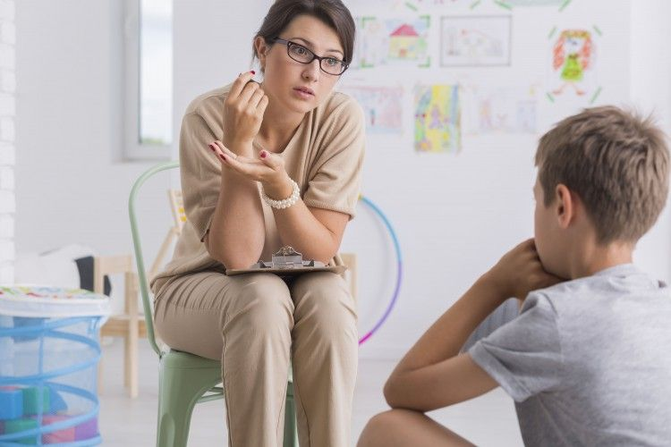 school counselor works with a student