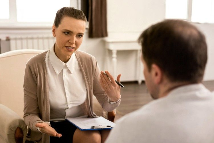 Mental health counselor talks with a client