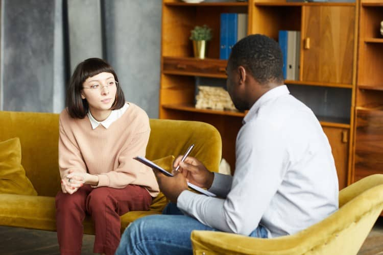 A counselor meets with a client.