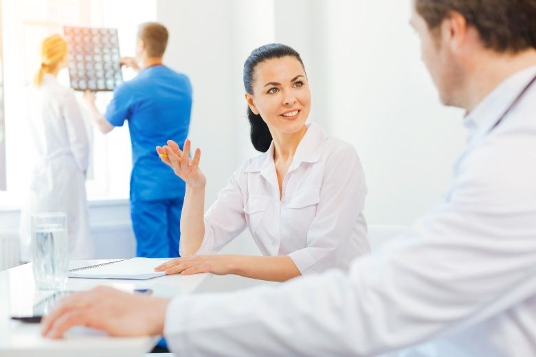 HR manager discusses with a healthcare employee.
