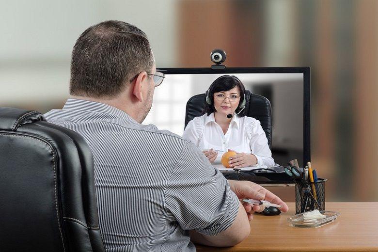 Alt: Patient receives treatment through a telehealth system