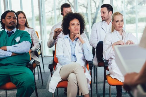 Healthcare workers attend ethics training.