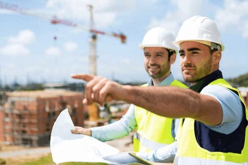 Safety professionals looking at building plans
