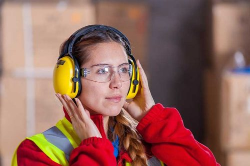 Woman wearing ear and eye protection
