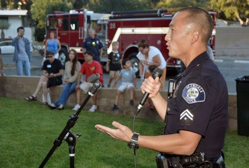 Police Officer speaking at a community event