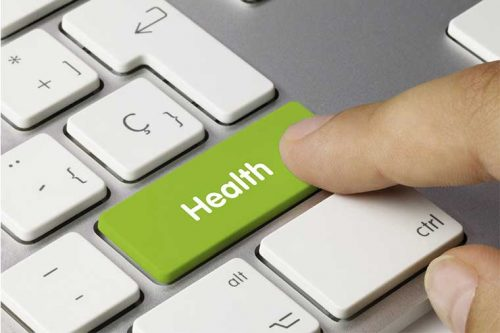 Person pressing a health button on a keyboard