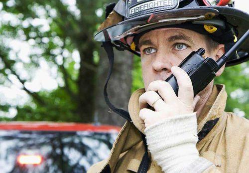 Firefighter using a walkie talkie