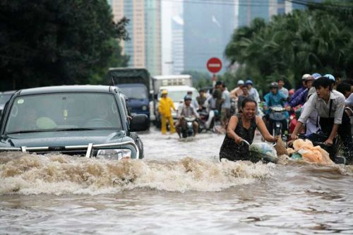 People moving through flood waters trying to get to safety