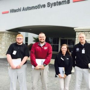 EKU students and professor standing in from of Hitachi Automotive Systems