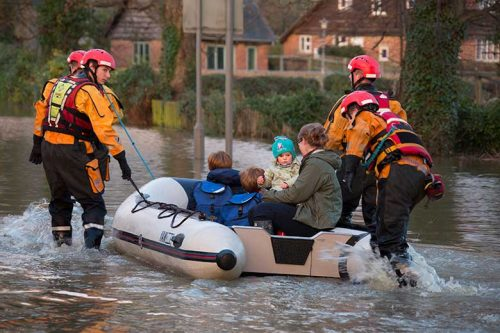 First responders helping people during a flood