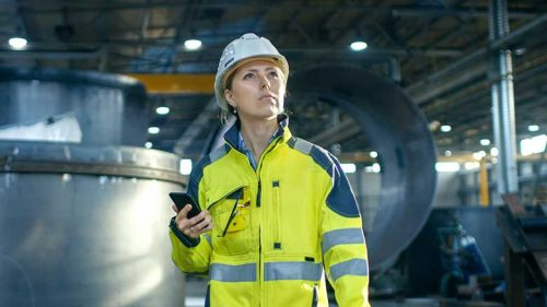 Safety Professional holding a smart phone