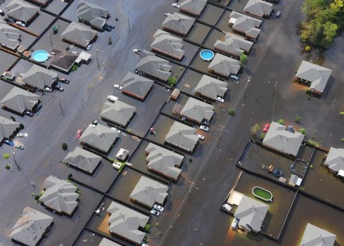 An aerial view of a flooded housing area