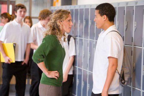 High school teacher talking to a student