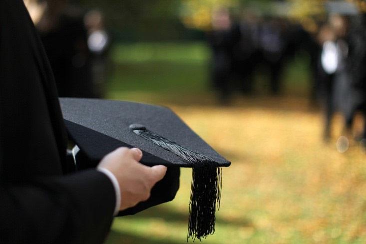 An engineering students prepares to graduate.
