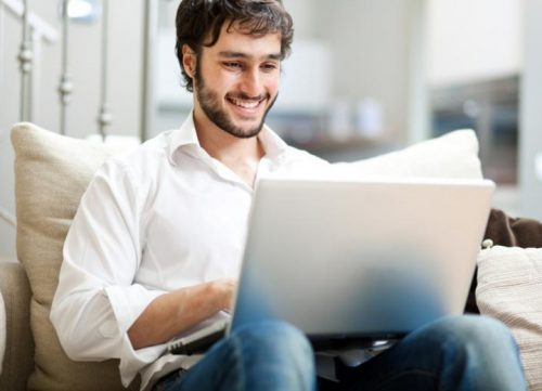online student studying on his couch