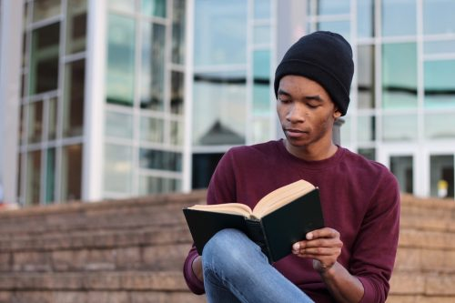 Healthcare MBA student studying with book in hand
