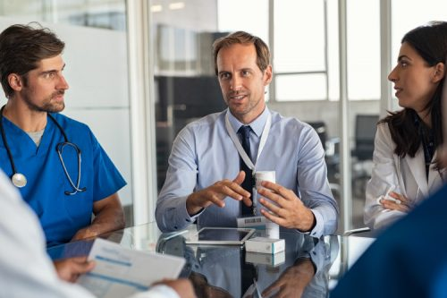 A hospital executive meets with the medical team.