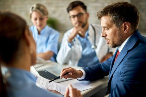 A healthcare marketing professional meets with a medical team.