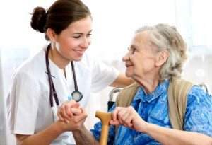 young female woman medical professional helping elderly woman patient