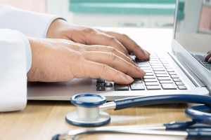 stethoscope and hands on keyboard