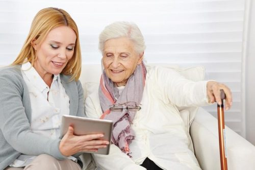 Social worker with senior patient