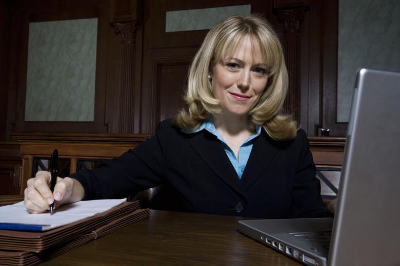 A legal professional studies on a laptop