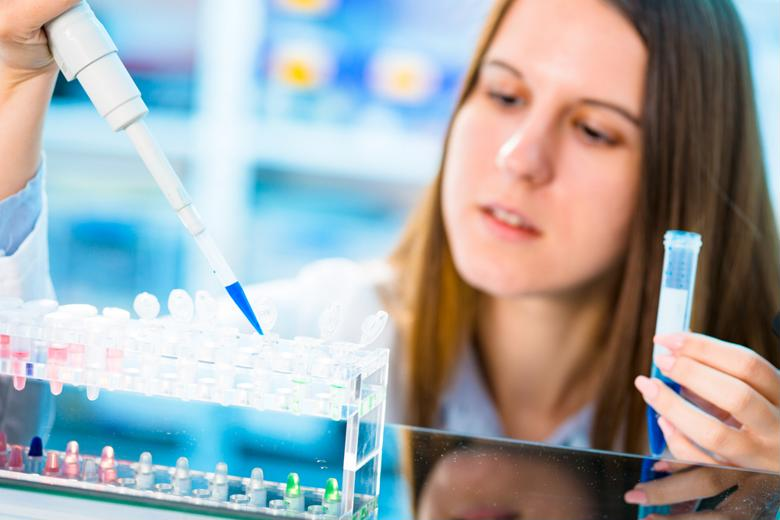 A clinical-researcher works on trials with test tubes