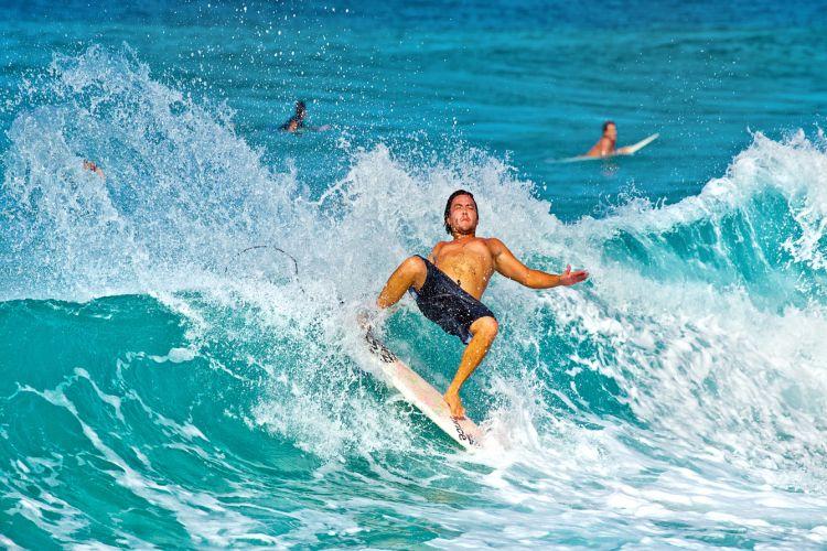 surfer loses balance and falls