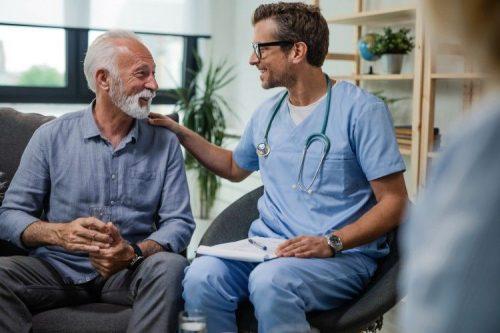 A nurse talks with an older adult.
