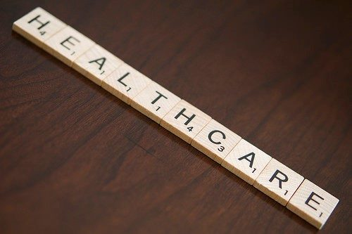Scrabble tiles spell out healthcare.