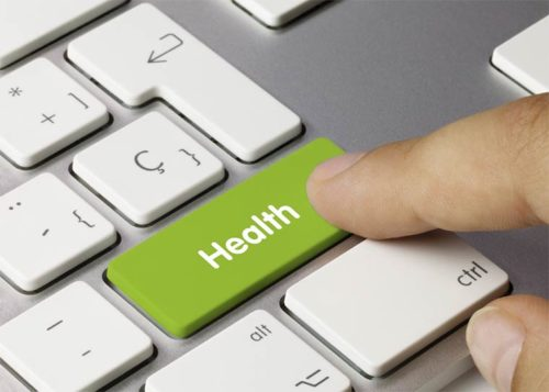 """A finger presses a key labeled """"health"""" on a computer keyboard."""